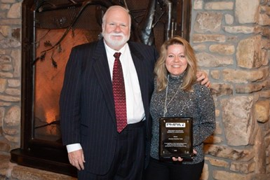 Absolute Machine Tools' Greg Knight, vice president of sales - production turning, and Courtney Ortner, chief marketing officer accepted the PMPA award.