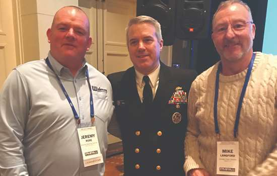 (l to r) Jeremy Rose from Wickman Machine Tool Inc., Vice Admiral Ronald Boxall, Mike Langford from Gosiger High Volume.