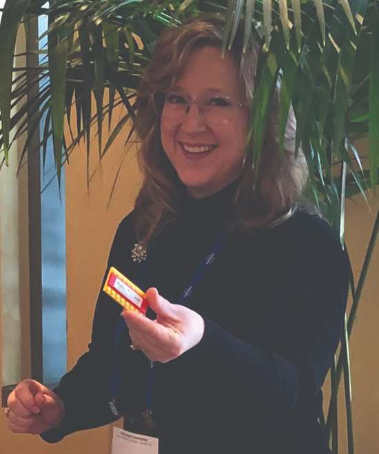 PMPA's Executive Director, Cate Smith, hands out LEGO® name tags to all attendees.