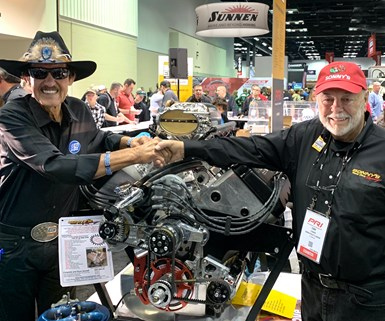 Richard Petty and Sonny Leonard with a car racing engine