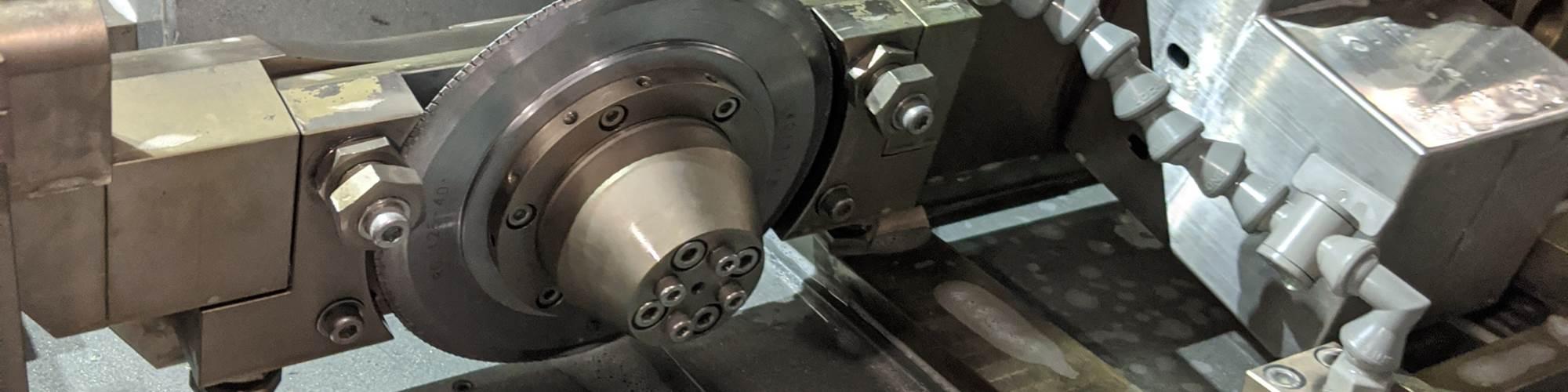 Amada grinding machine with a CNC trunnion dresser