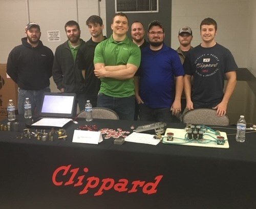 students from Clippard standing behind table at open house