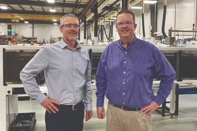 Tom Halladay and Tim Halladay on the floor at H&R Screw Machine Products.