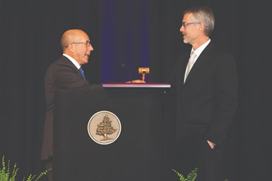 Victor DaCruz hands the president's gavel to Tom Halladay at the Annual Awards Banquet.
