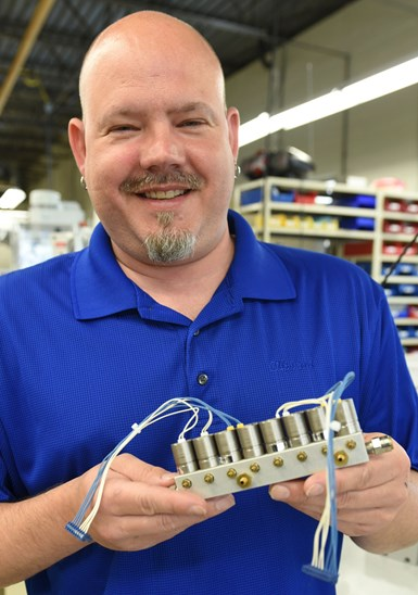 Shawn Reitenbach holding a sub-assembly