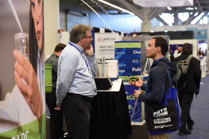 PMTS attendee visits booth on show floor