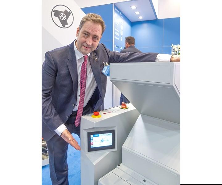 Mark Hellweg, managing director, shows off the new GRANUmaster smart control.