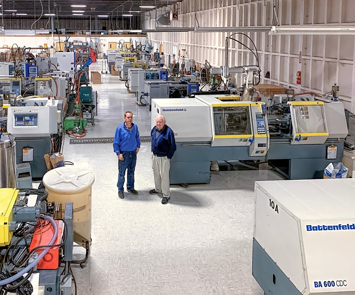 T&M founder and president Tom Paquin (rt.) with his son, T.R. Paquin, operations manager, in their all-Battenfeld plant.
