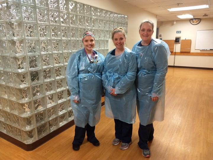 Petoskey Making Isolation Gowns