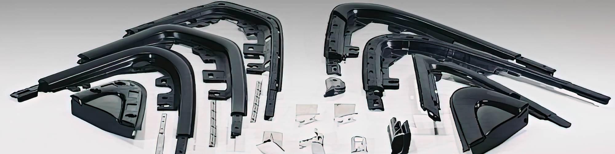 Two-shot overmolded automotive trim parts