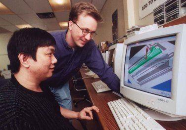 CAM programmers Tin Nguyen, left, and Ed Mueller