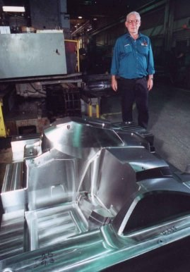 Cavalier Tool & Manufacturing co-founder Rick Janisse with a large injection mold.
