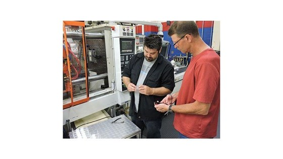 Darin Von-Asten (on left), MGS sampling process technician, and Kevin Klotz, MGS senior project engineer for simulation services