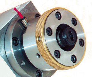 A belt-driven block spindle