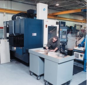 A machinist making and measuring molds.