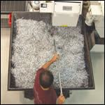 Fast cycle time keeps machine operator Victor Martinez busy emptying the machine's chip bin