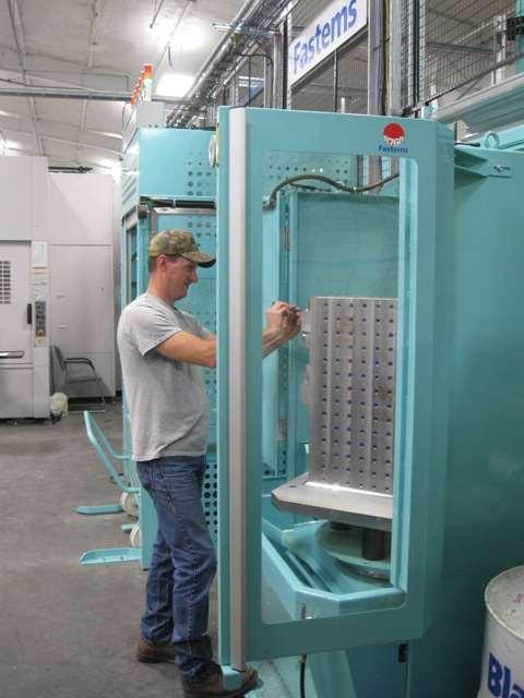 Operator works at load/unload station