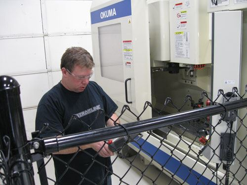 Dennis Paulson fine-tuning a robot cell