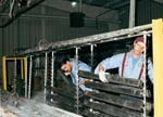 Employees rack aluminum pieces