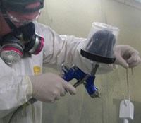 Painters at Esterline Hytek spray a variety of paint materials
