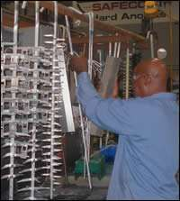 An operator readies racked parts