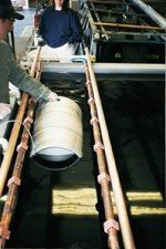 keg is lowered into the electropolishing bath