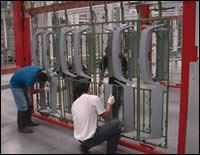 Production workers rack Jetta grill parts