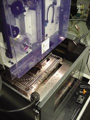 Submerged EDM'ing with automatic wire threading