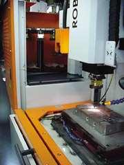 A CNC drop tank EDM