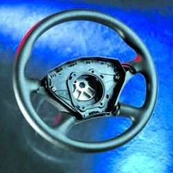 Airbag container mounted in steering wheel