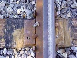E-glass wrapped railroad tie