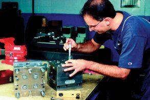 A toolmaker makes a final check