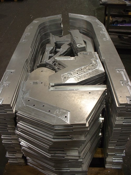 multiple components machined from an aluminum plate