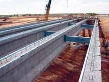 Bridge with composite reinforcing elements