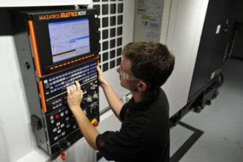 student on Mazak machining center